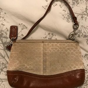 Cream and tan Coach wristlet